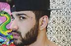 Gusttavo Lima faz tatuagem no rosto em forma de cruz (Instagram / reprodução/)