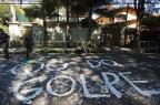 """Conheça o grupo por trás dos """"escrachos"""" NELSON ALMEIDA/AFP"""