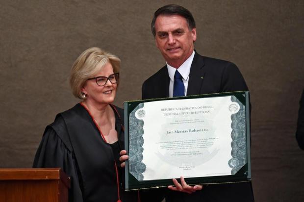Em diplomação, Jair Bolsonaro pede confiança daqueles que não votaram nele Evaristo Sá/AFP