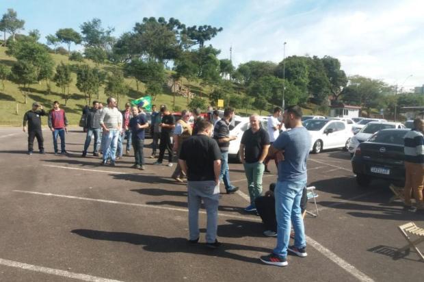 Dezenas de motoristas de Uber protestam nos pavilhões da Festa da Uva Marcelo Passarella/Agência RBS