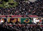 Imagens de serragem colorida são mensagens em forma de tapetes em Corpus Christi Antonio Valiente/Agencia RBS