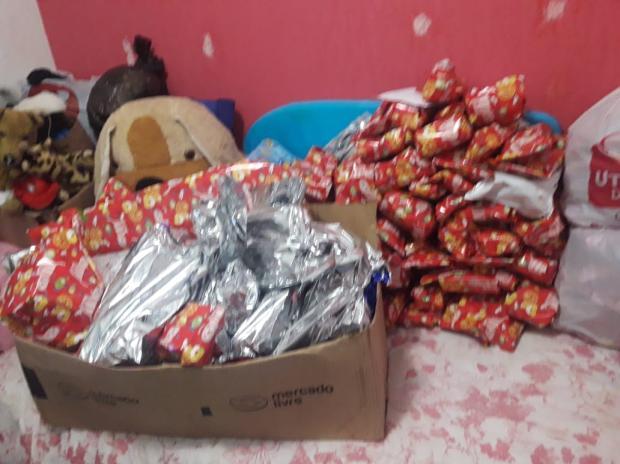 Voluntários distribuem brinquedos para 300 crianças do bairro Santa Tereza, em Caxias Divulgação  / Divulgação /Divulgação