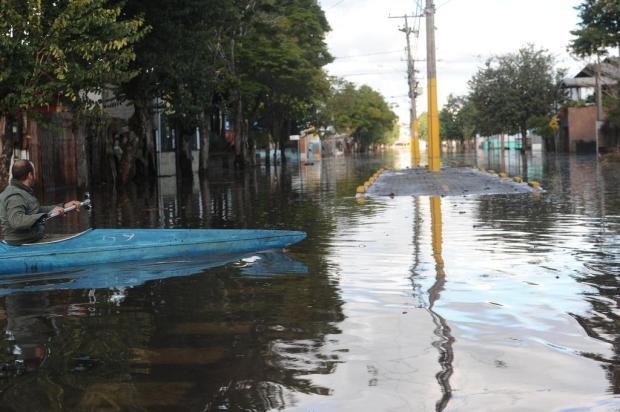 Moradores que vivem às margens do rio temem ser transferidos para área de criminalidade em São Sebastião do Caí Antonio Valiente/Agencia RBS